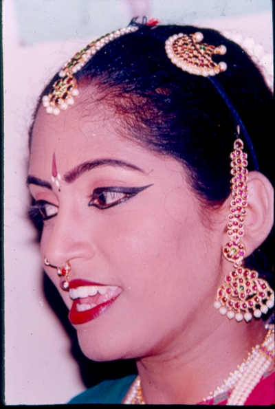 A female dancer with nose head ear arnaments