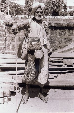 Beggar with Drums Outside a Temple