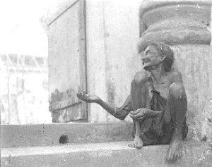 A beggar at the Mangeshi temple, Goa