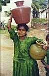 Girl Fetching Water for Household Use