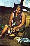 Konkani woman at work - notice her blouseless  traditional sari
