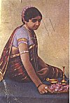 Woman in festive clothing prepares for worship<br>From a 1940s Picture Post-card