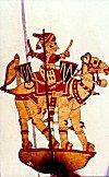 Camel Riding Warrrior beating War Drums