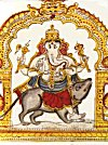Lord Ganesh rides his favorite mouse to earth