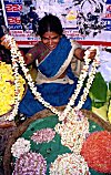 Woman selling flower garlands