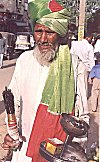Beggar by choice: A Sufi fakir seeks alms on the street