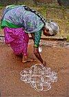 Woman in Sari Decorates the Front Yard