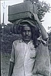 A Devotee Walking to Nagadwara for the Snake Festival